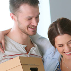 happy couple with moving boxes