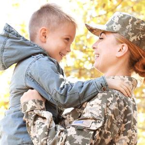 female veteran holding her son