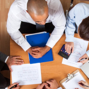 group of business people with paperwork