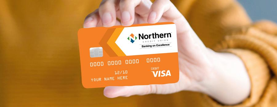 woman holding a northern credit card - Free Visa Credit Card