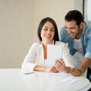 Couple using online tablet
